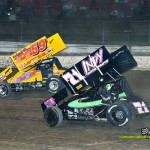 Kevin Swindell (#71) racing with Jac Haudenschild (#59) Saturday at Eldora Speedway. - Mike Campbell Photo