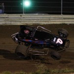 Steve Irwin gets upside down on Friday at Waynesfield Raceway Park. - James McDonald / Apexonephoto