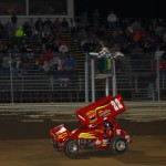 Randy Hannagan taking the checkered flag Friday at Waynesfield Raceway Park. - James McDonald / Apexonephoto