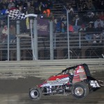 Thomas Meseraull takes the checkered flag Saturday at Waynesfield Raceway Park. - Jan Dunlap Photo