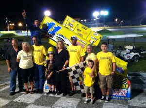 Joey Aguilar pictured here with the Riddle family after winning the Frank Riddle Memorial on Saturday at Citrus County Speedway. - TBARA Photo