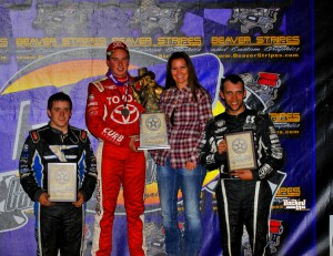 After winning Thursday night's USAC National Midget feature win at Canyon Speedway Park's 46th Annual Western World Championships, Christopher Bell is joined on the podium by runner-up Brady Bacon (left) and Bryan Clauson (right).  (Patrick Shaw photo)