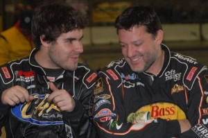 """Three-time NASCAR champion Tony Stewart (right) shares a moment with fellow driver Cap Henry at last year's """"Rumble in Fort Wayne."""" Despite a broken leg that continues to keep him out of a race car, Stewart will return as a car owner for the 16th annual indoor midget races on Friday, Dec. 27 and Saturday, Dec. 28 at the Memorial Coliseum Expo Center. He'll also greet fans and sign autographs both days. / Photo by Jim Morrison/Hawkeye Racing News"""