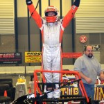 Russ Gamester celebrates winning the Rumble Racing Series event at the Memorial Coliseum Expo Center on Friday night December 27, 2013. - Bill Miller Photo