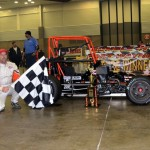 Russ Gamester in Victory Lane after winning the Rumble Racing Series event at the Memorial Coliseum Expo Center on Friday night. - Bill Miller Photo