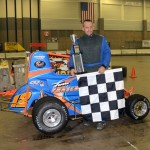 Tom Fraschetta in Victory Lane after winning the Non-Winged Outlaw Modified Midget feature event at the Memorial Coliseum Expo Center on Friday night. - Bill Miller Photo