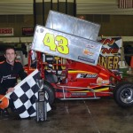 Matt Janisch in Victory Lane after winning the Winged Outlaw Modified Midget feature event at the Memorial Coliseum Expo Center on Saturday night. - Bill Miller Photo