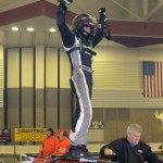 Justin Peck celebrates winning the Rumble Racing Series event at the Memorial Coliseum Expo Center on Saturday night December 28, 2013. - Bill Miller Photo