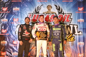(l to r)Second place Damion Gardner, winner Christopher Bell, and third place Michael Pickens in victory lane after Thursday night at the Chili Bowl Nationals. - James McDonald / Apexonephoto