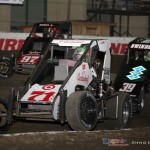 Kyle Larson (#71), Christopher Bell[ (#97) and Kevin Swindell (#39) race for position in the Vacuworx Race of Champions at the Chili Bowl Nationals. - Serena Dalhamer Photo