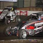 Tyler Courtney (#11w) outside of Zach Daum during the Tuesday night feature at the Chili Bowl Nationals. - Serena Dalhamer Photo
