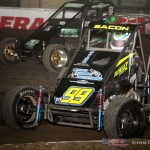 Tim Crawley (4J) racing with Brady Bacon (#99) at the Chili Bowl. - Serena Dalhamer Photo