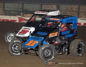 Andrew Felker (#11) inside of Shane Gobolic (#26) at the Chili Bowl Nationals. - Serena Dalhamer Photo