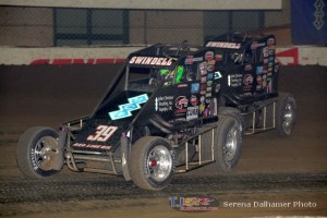 Kevin Swindell (#39) inside of Sammy Swindell (#1) at the Chili Bowl Nationals. - Serena Dalhamer Photo
