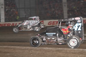 Bryan Clauson (#63) racing for the lead with Tim McCreadie (#47) Friday at the Chili Bowl Nationals. - James McDonald / Apex One Photo