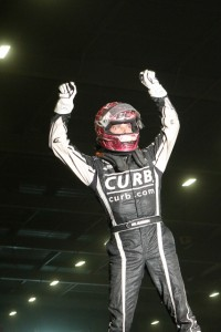 Bryan Clauson emerges from his car victorious. - James McDonals / Apexonephoto