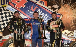 Trevor Green (center) in victory lane with Kraig Kinser (right) and Ben Atkinson on the podium at Syndey Speedway. - Image courtesy of Sydney Speedway