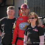 Dave Darland poses with his car owners. - Bill Miller Photo