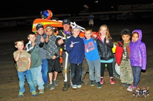 Christopher Parkinson and crew after winning the Wingless Auto Racing feature at Humboldt Speedway.  - John Lee www.highfly-nphotos.com
