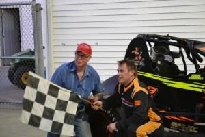 John Turnbull, Jr. with car owner John Hotchkiss after winning Friday night at Spartan Speedway. - Bob Buffenbarger Photo