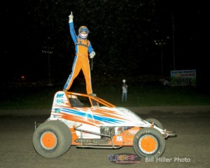 A.J. Hopkins up on the cage to celebrate winning Friday night's feature at Gas City I-69 Speedway. - Bill Miller Photo