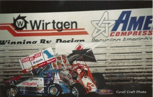Mark Kinser and Sammy Swindell's 1997 Knoxville Nationals coming to an end.  - Cyndi Craft Photo