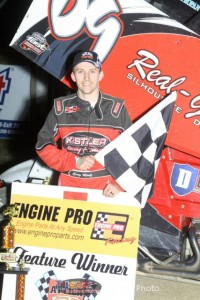 Craig Mintz in victory lane after winning Friday night at Attica Raceway Park. - Action Photo