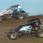 Dustin Ingle (#2) inside of Mark Silva (#5) Saturday at Waynesfield Raceway Park. - Mike Campbell Photo