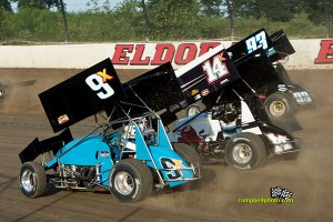 Rob Chaney (#9x), Dale Blaney (14K), and Sheldon Haudenschild (#93) racing three wide at Eldora Speedway. - Mike Campbell Photo