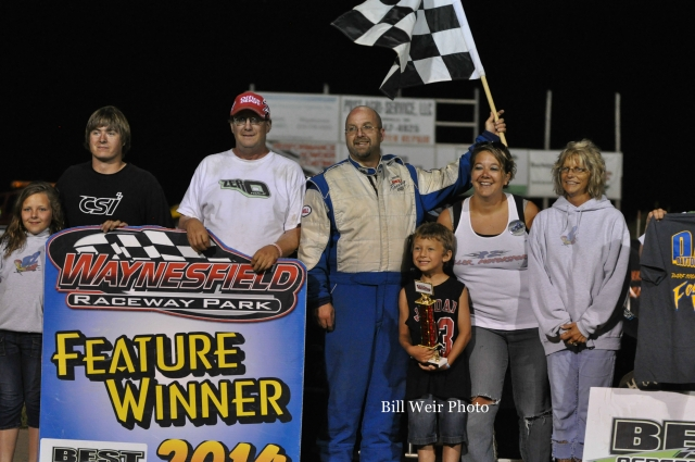 Mike Miller in victory lane Saturday at Waynesfield Raceway Park. - Bill Weir Photo