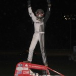 Chad Boespflug celebrates after winning the 25 non-wing sprint car feature event at the Gas City I-69 Speedway on Friday night June 27, 2014. - Bill Miller Photo