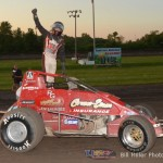 Jerry Coons, Jr. salutes the crowd after winning Friday night's sprint car feature at Gas City I-69 Speedway. - Bill Miller Photo