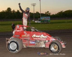 erry Coons, Jr. salutes the crowd after winning Friday night's sprint car feature at Gas City I-69 Speedway. - Bill Miller Photo