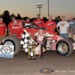 Jerry Coons, Jr. with this team in victory lane on Friday night at Gas City I-69 Speedway. - Bill Miller Photo