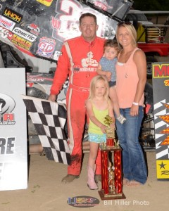Greg Wilson with his wife and daughter in victory lane Saturday at Montpelier Motor Speedway. - Bill Miller Photo