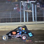 Mike Miller takes the checkered flag at Waynesfield Raceway Park. - Jan Dunlap Photo