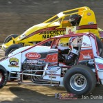 Nick Daugherty (#7) inside of Logan Hupp (#2) Saturday at Waynesfield Raceway Park. - Jan Dunlap Photo