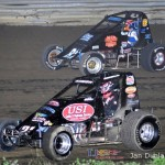 Kyle Simon (#22) inside of Mike MIller (#82) Saturday at Waynesfield Raceway Park. - Mike Campbell Photo