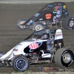 Todd Keen (#18) inside of Mike Miller (#82) Saturday at Waynesfield Raceway Park. - Mike Campbell Photo