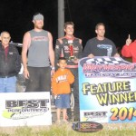 Kyle Simon and team in victory lane after winning the feature Saturday at Waynesfield Raceway Park. - Jan Dunlap Photo