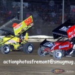 Dean Jacobs (#97) racing Craig MIntz (#09) Friday at Attica Raceway Park. - Action Photo