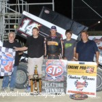 Dale Blaney woo feature winner in victory lane with his crew. - Action Photo