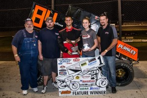 Alex DeCamp is joined in victory lane by AmeriFlex Hose & Accessories owner Corvan Robison (left), his son Logan, Nicole Baker and promoter Dave Edwards (right). Mike Spivey Photo