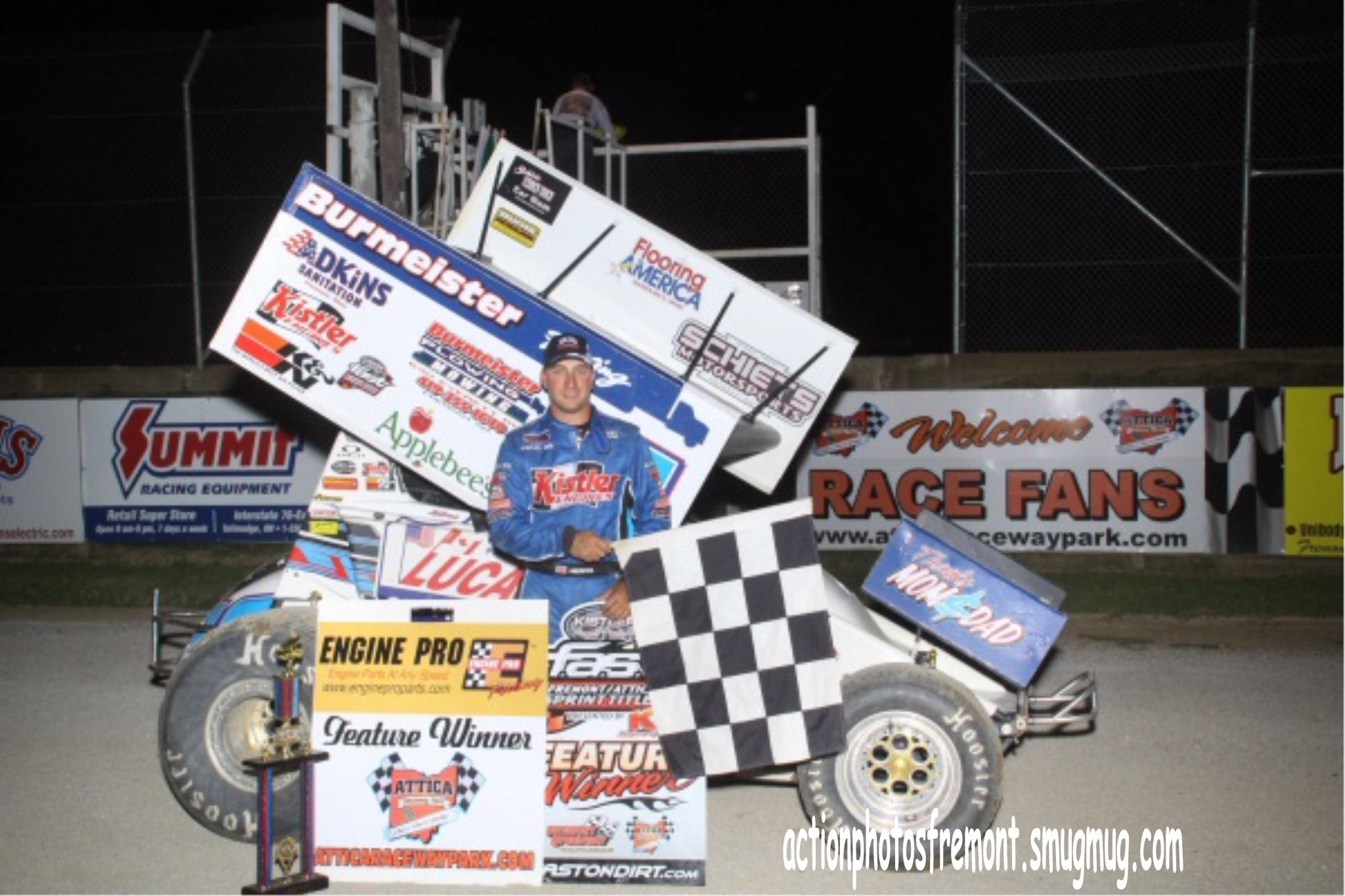 Chris Andrews celebrating in victory lane at Attica Raceway Park. - Action Photo