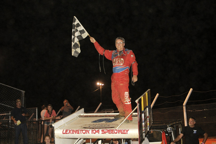 Jeff Swindell walked the wing of the Hammers Racing No. 94 on Friday night, winning with the Lucas Oil ASCS National Tour at the Lexington 104 Speedway. (ASCS / Rob Kocak)