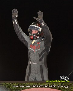 Shane Stewart emerging from his car following his victory Friday at Knoxville Raceway. - Mike Campbell Photo