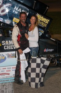 Aaron Pierce celebrates with his wife Amy after winning the Must See Racing MOFAB Labor Day 200 Saturday night at Anderson Speedway. - David Sink Photo