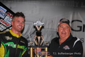 Troy DeCaire receiving the trophy for winning Saturday night's Must See Racing feature at Berlin Raceway. - T.J. Buffenbarger Photo
