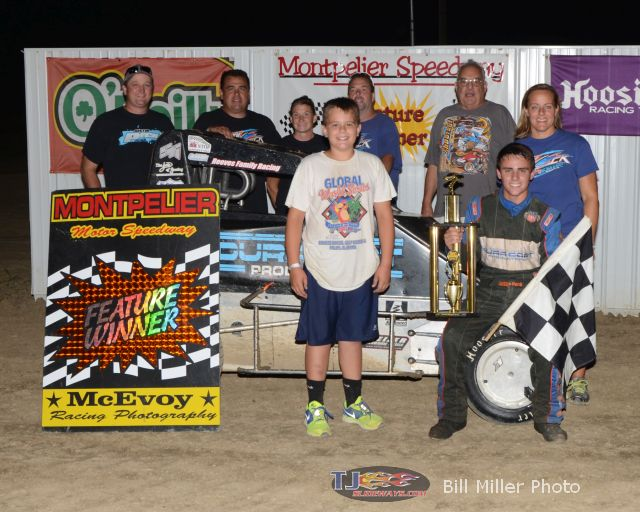 Justin Peck in Victory Lane with family and crew after winning the 20 lap midget feature event at the Montpelier Motor Speedway on Saturday August 30, 2014. - Bill Miller Photo