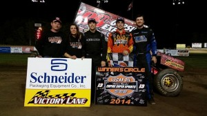 Winner Larry Wright (center) flanked by second place Jason Barney (right) and Parker Evans (left) along with Kevin and Pam Ward (far left). - ESS Photo